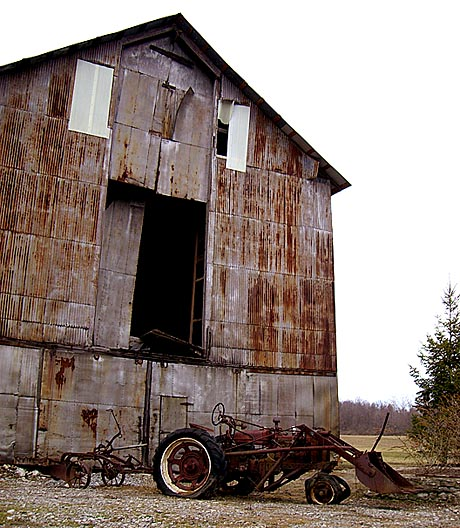 Driving down North Road in LeRoy today, I came across this old barn and broken down tractor.