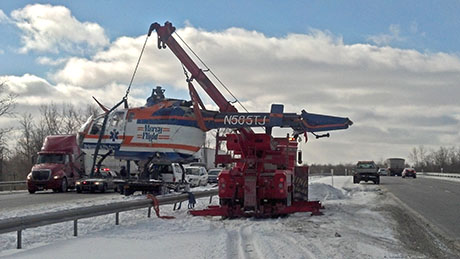 Truck Hauling Helicopter On Thruway Crashes In Pembroke