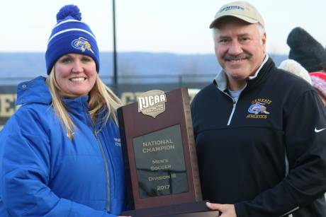 gcc_athletic_director_kristen_schuth_left_poses_with_gcc_president_dr._james_sunser_right_with_the_njcaa_national_title_plaque_for_mens_soccer_sunday.jpg