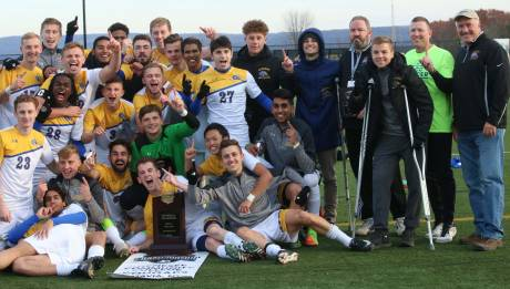 gcc_president_dr._james_sunser_far_right_joins_the_mens_soccer_team_for_a_team_photo_after_winning_their_first-ever_njcaa_title_in_herkimer_sunday.jpg