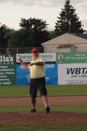 Lions Club President John Murray throws out the first pitch